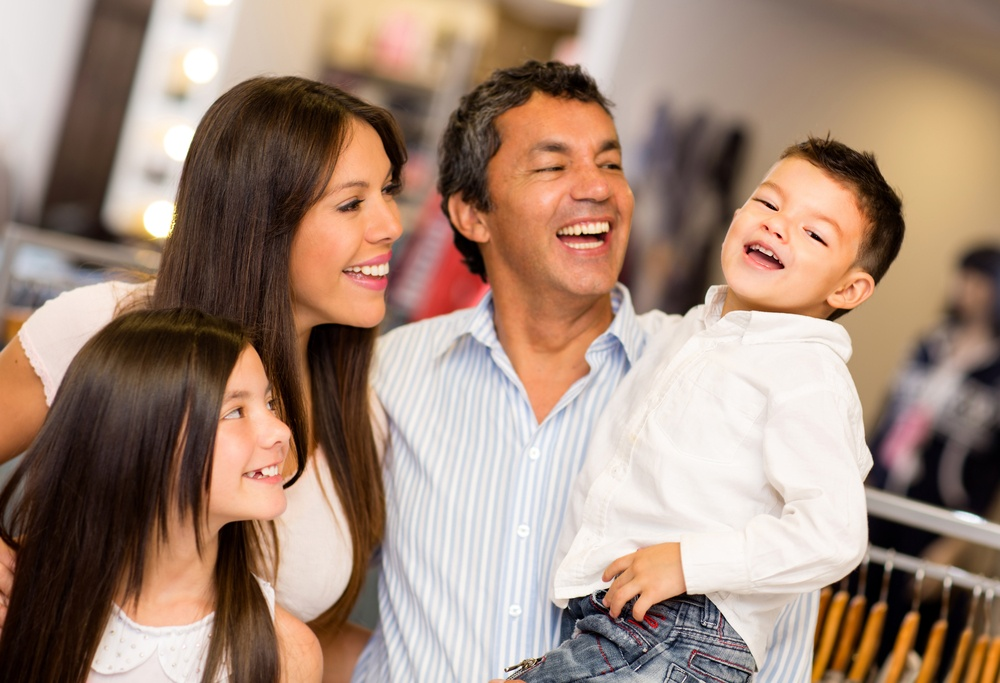 Multicultural Family laughing together